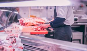 Custom meat cutting, butcher cutting raw meat